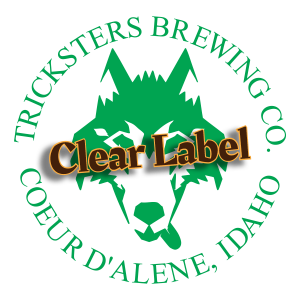 Tricksters Brewing Co. Idaho clear promotional label with green printing.